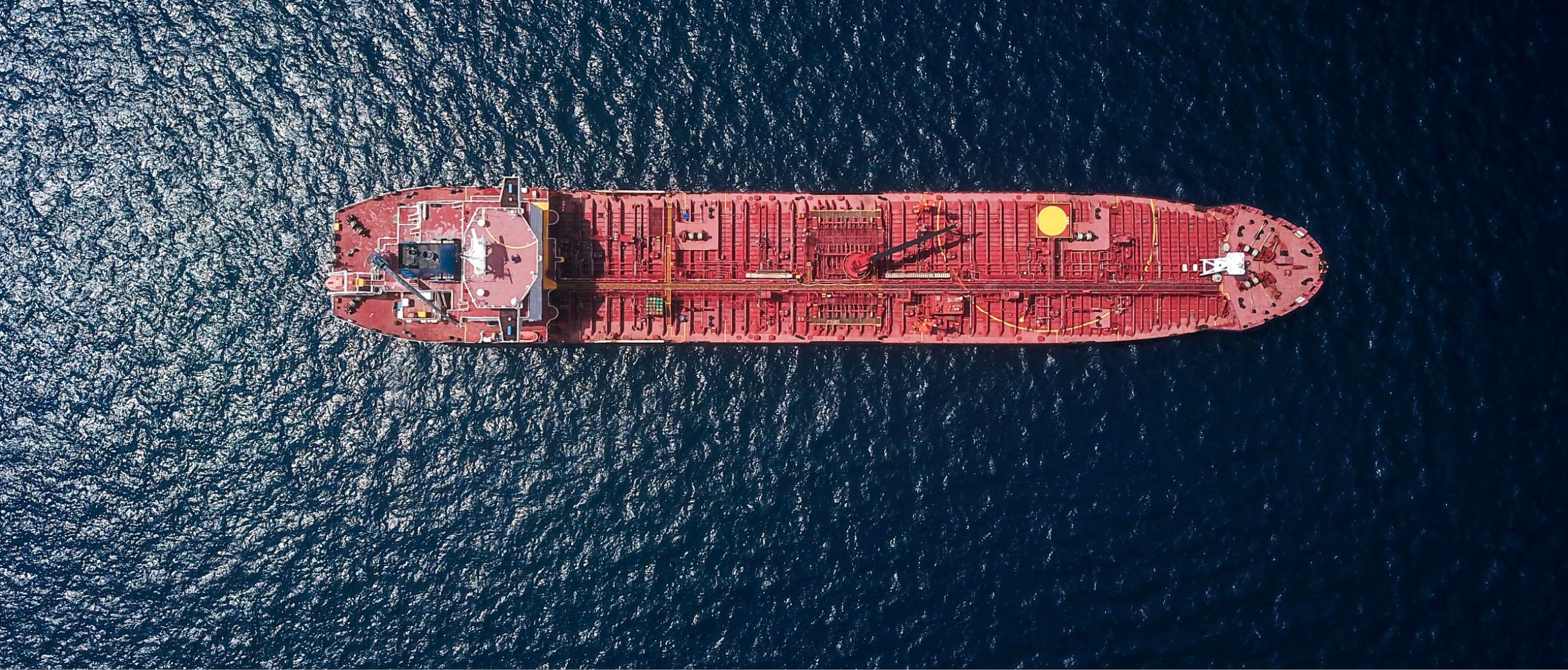 Aerial view of a ship surrounded by water. Photocredit: Shaah Shahidh, Unsplash